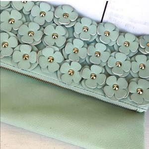 Aldo mint green floral appliqué clutch